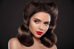 Elegant hairstyle. Beauty girl makeup. Retro portrait of beautif Royalty Free Stock Photography
