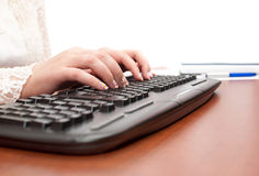 Elegant hands typing on the keyboard Royalty Free Stock Photo