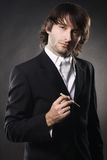 Elegant handsome man with a cigar Royalty Free Stock Image
