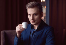 Elegant handsome man with cup of coffee Royalty Free Stock Image