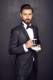 Elegant handsome man drinking coffee Royalty Free Stock Images