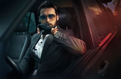 Elegant handsome man driving a car Royalty Free Stock Photos