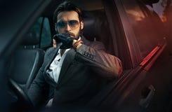 Elegant handsome man driving a car Royalty Free Stock Photos