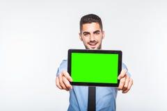 Elegant handsome man showing a tablet Stock Image