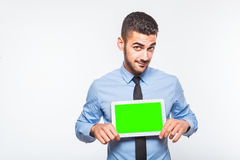 Elegant handsome man showing a tablet Royalty Free Stock Photography
