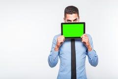 Elegant handsome man showing a tablet Stock Photos