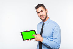 Elegant handsome man showing a tablet Royalty Free Stock Photo