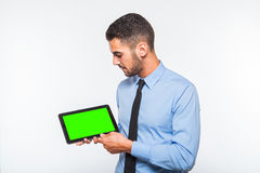Elegant handsome man showing a tablet Royalty Free Stock Image