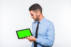 Elegant handsome man showing a tablet Royalty Free Stock Image