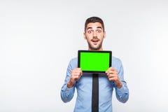Elegant handsome man showing a tablet Royalty Free Stock Images