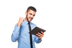 Elegant handsome man using a tablet Stock Photography
