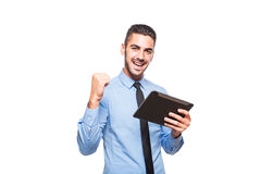 Elegant handsome man using a tablet Royalty Free Stock Images