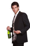 Elegant handsome man with wine bottle. And two glasses in hand. Celebration concept . Isolated on white Royalty Free Stock Image