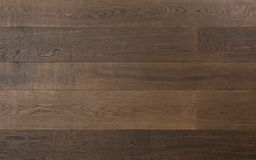 Hardwood flooring. Elegant hardwood flooring made of dark textured wood planks stock photo