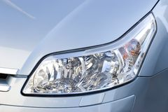 Elegant headlight close-up. Headlight of modern elegant vehicle, close-up shot Stock Photo