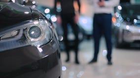 Elegant headlight of electric car stock video