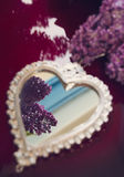 Elegant heart-shaped mirror and lilac flowers Royalty Free Stock Image