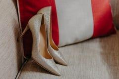 Elegant High heel womens shoes on sofa. Classic footwear. Brides wedding shoes. Modern style. Horizontal shot. Fashion concept stock photo