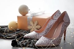 Elegant high heeled shoes and gift box Royalty Free Stock Image