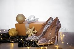 Elegant high heeled shoes and gift box Stock Photo