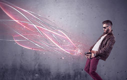 Elegant hipster with camera and bright lines Royalty Free Stock Photos
