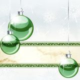 Elegant holiday banner with transparent ornaments. Green and white Christmas banner with transparent glass ornaments. Graphics are grouped and in several layers Royalty Free Stock Image