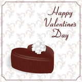 Elegant holiday card with a chocolate candy in the form of the heart, background with ornament and inscription Valentine`s Day. Su Stock Image