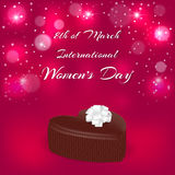 Elegant holiday card red. Chocolate candy in the shape of a heart and an inscription with the International Women`s Day on March 8. Vector Stock Image