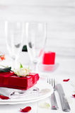 Elegant holiday table setting with red ribbon gift Royalty Free Stock Photo