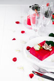 Elegant holiday table setting with red ribbon gift Stock Photography