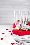 Elegant holiday table setting with red ribbon gift Stock Image