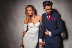Elegant hot couple in dramatic pose Stock Photos