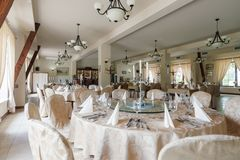 Elegant hotel dining room. Photo of elegant dining room with round tables Stock Photos