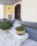 Elegant house entrance and flower pots Stock Image