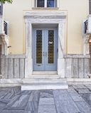 Elegant house entrance with wooden door, Athens  Greece. Elegant house glamorous entrance with pale light blue wooden door, Athens Greece Stock Images