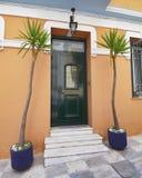 Elegant house green door and yucca plants, Athens Greece Stock Photos