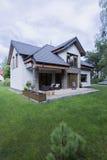 Elegant house with patio and garden Stock Photos