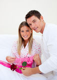 Elegant husband giving a present to his wife Stock Photos