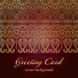 Elegant Indian ornamentation on a dark background. Stylish design. Can be used as a greeting card or wedding invitation Royalty Free Stock Images