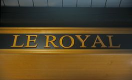 Elegant indoor sign Le Royal at wooden sealing. Elegant indoor logo Le Royal at wooden sealing royalty free stock images