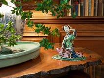 Elegant interior with japanase porcelain figure. And bonsai tree Stock Photography