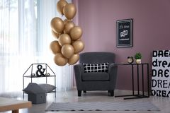 Elegant interior of living room with air balloons royalty free stock image