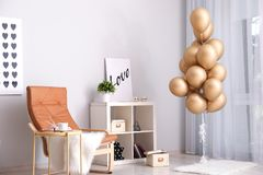 Elegant interior of living room with air balloons stock image