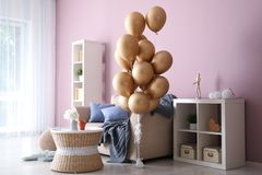 Elegant interior of living room with air balloons stock photo