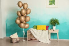 Elegant interior of living room with air balloons royalty free stock photography