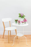 Elegant interior with table, chair and spring flowers royalty free stock images