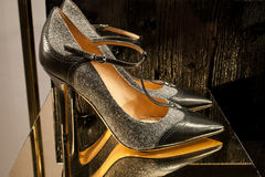 Elegant italian women shoe. Women shoe shop in Florence Italy.Shoes with black leather and gray fabric  very interesting combination Royalty Free Stock Photos