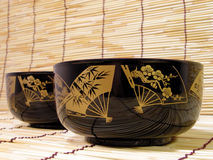 Elegant Japanese bowls. Elegant and traditional bowls on the bamboo straws floor.Only crafts and usual object(similar with a normal plate Stock Photos
