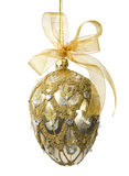 Elegant Jeweled Egg Ornament. Elegant gold and silver bejeweled egg-shaped ornament with gold mesh bow (includes clipping path stock image
