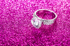 The elegant jewellery on shiny background Royalty Free Stock Photography